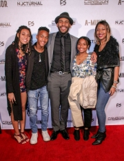 TayLore Reliford, RJ Reliford, director JR Strickland, TaMya Reliford, and LaTonya Reliford attend the premiere of 'A-Minor' at Raleigh Studios in Hollywood.