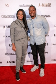 Comedian Calvin Evans and guest attend the premiere of 'A-Minor' at Raleigh Studios in Hollywood.