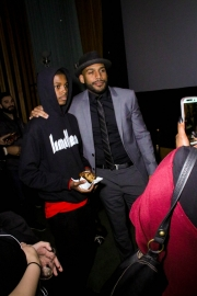 Director JR Strickland takes pictures with guests at the premiere of 'A-Minor' at Raleigh Studios in Hollywood.